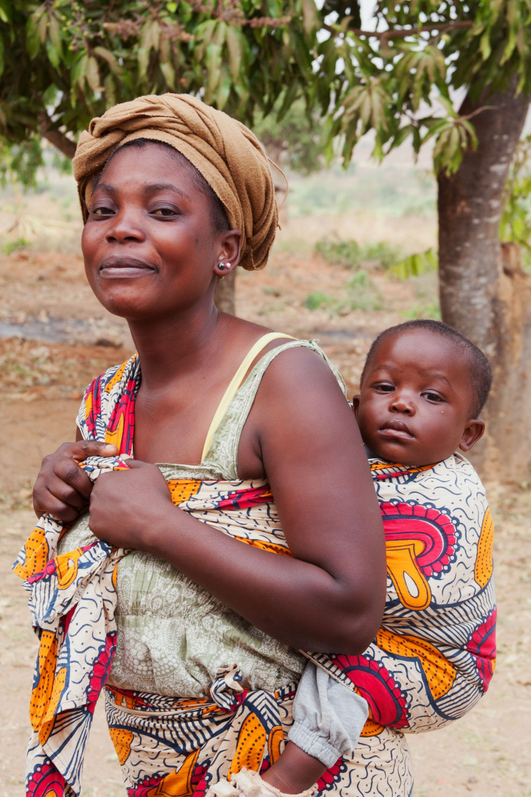 woman with baby carried on back
